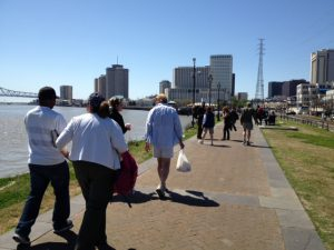 Ministering with bags of burgers and socks along the river in NOLA.