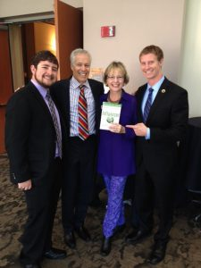 Joe Grenny with Mary Ellen of MarketingMel along with Roan Scholars Lucas Hitechew and Matthew Pencarinha.