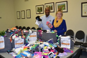 United Way of Washington County TN and Mary Ellen Miller of MarketingMel with  over 1,000 pairs of new socks for the homeless.