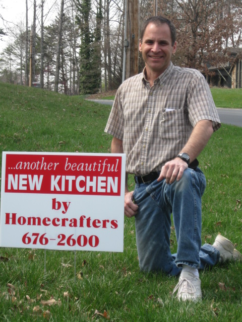 Tom with Homecrafters sign