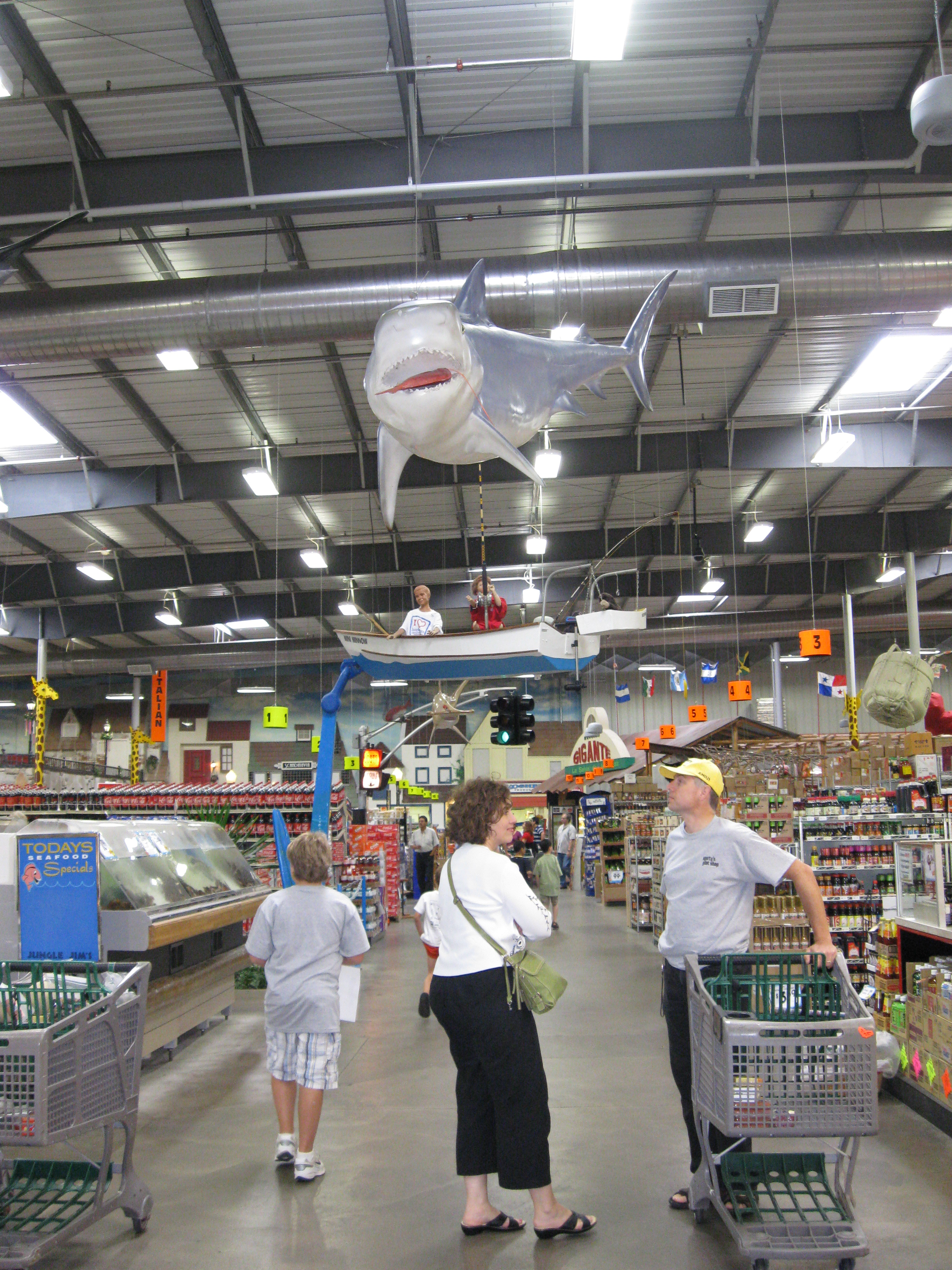 A shark watches over customers in Jungle Jim's sea food section