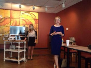 MarketingMel's Mary Ellen Miller at a recent public speaking engagement along with Sarah Kinsler in the background.