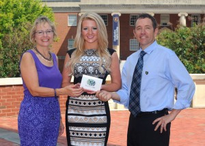 Mary Ellen Miller of MarketingMel, and Dr. Stephen Marshall of ETSU award the new scholarship to Alex Quillin.