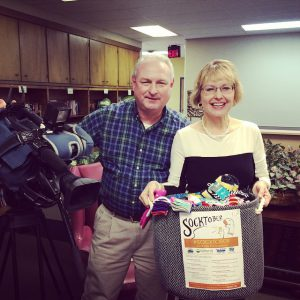 WCYB-TV videographer Tim Culbertson and Mary Ellen MIller of MarketingMel show off some of the #Socktober sock donations.